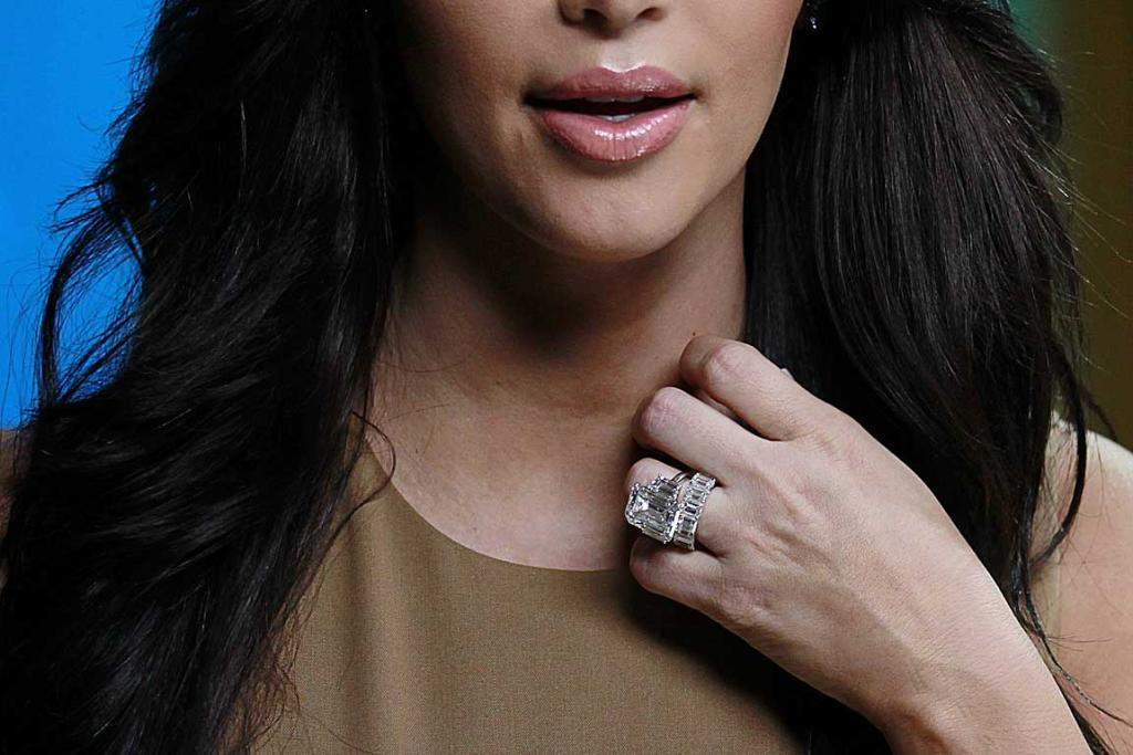 ALL OVER: Kim Kardashian has taken off her wedding ring since being pictured with it in October.