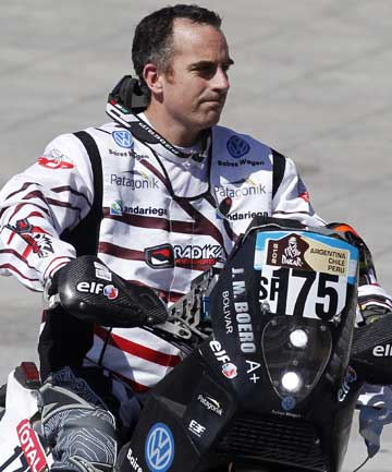 DAKAR DEATH: Argentine rider Jorge Andres Martinez Boero  drives his Beta JMB from the podium during the departure ceremony of the fourth South American edition of the Dakar Rally. Boero, 38, died January 1, 2012, after falling from his motorcycle during the first stage.