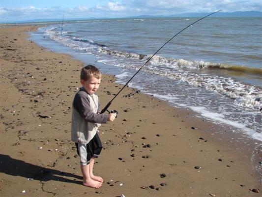 FISH BUSINESS: Steve Davison, from Cambridge, grabbed a photo of Ben reeling in at Te Puru.