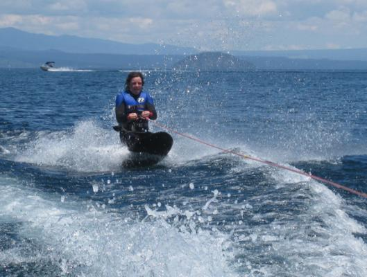 WET AND WILD: Lake Taupo provided the perfect setting for Janine Vicars to snap her son kneeboarding.