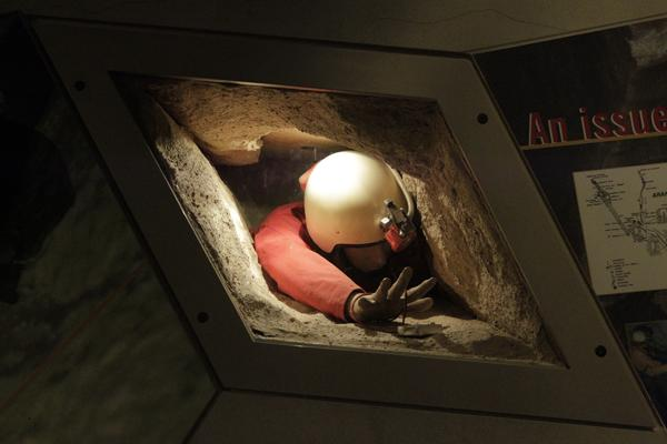 TIGHT SQUEEZE: A model of a climber in a crawl space.
