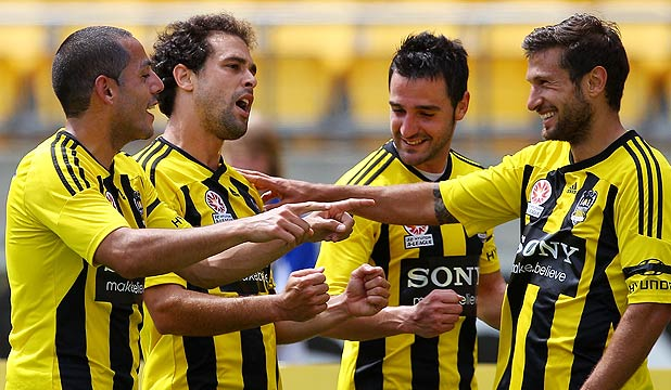 Phoenix players Leo Bertos, Daniel Sanchez and Vince Lia celebrate Daniel's (second from left) goal from the penalty spot against Sydney FC in Wellington.