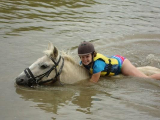 GIDDY-UP: Elisa appears to have found herself a seashore while at a horse camp at Lakewood Lodge.