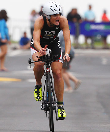 OLD GIRL: Joanna Lawn on the bike at the Port of Taurangi Half Ironman.