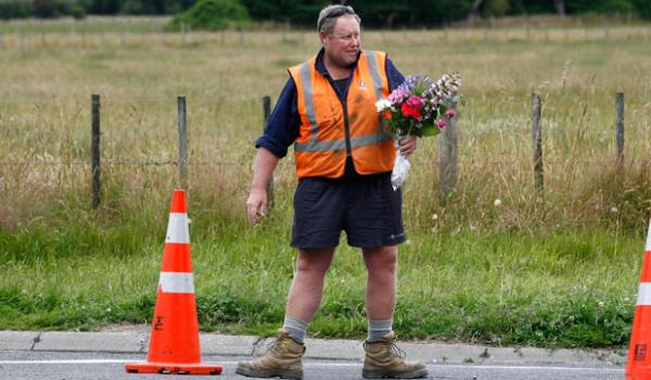 Flowers being placed on Somerset Road near the site of the fatal balloon crash.