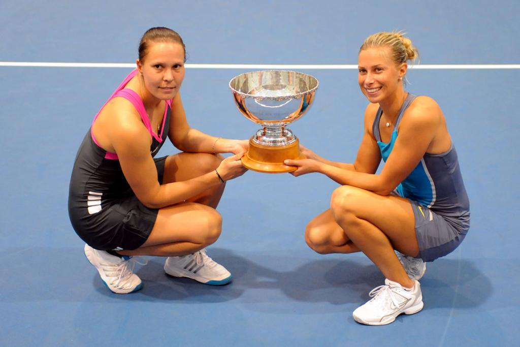 Andrea Hlavakova and Lucie Hradecka hold the doubles trophy after beating Juila Goerges and Flavia Pennetta.