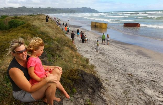 Onlookers flock to Waihi beach to check out the Rena cargo.