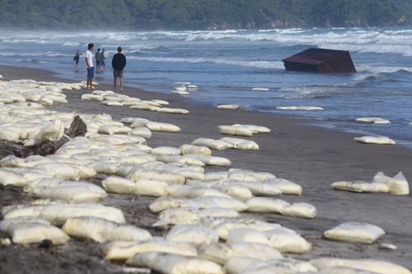 A container floats to the Waihi beach, along with a huge number of sacks with milk powder.