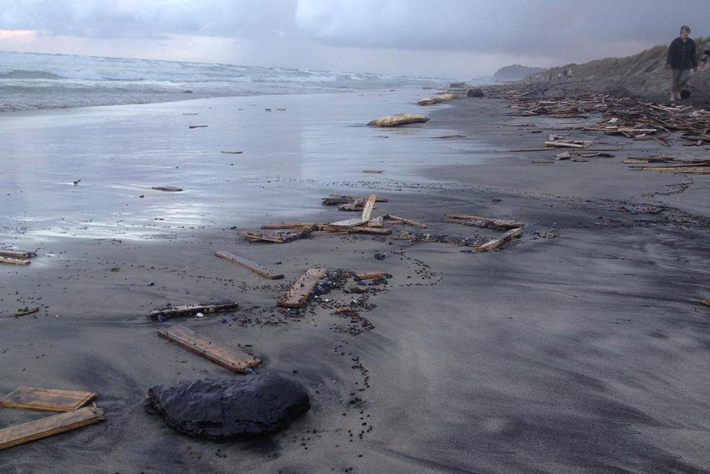 Oil washed up on Waihi Beach.