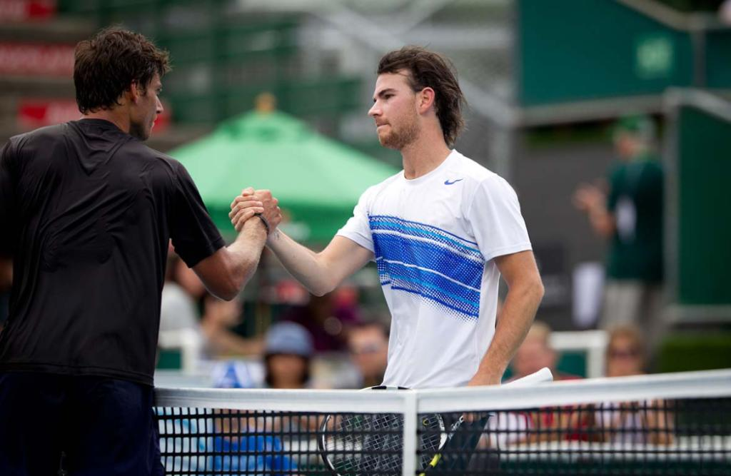 Artem Sitak congratulates France's Adrian Mannarino on the win on day one of the Heineken Open in Auckland.