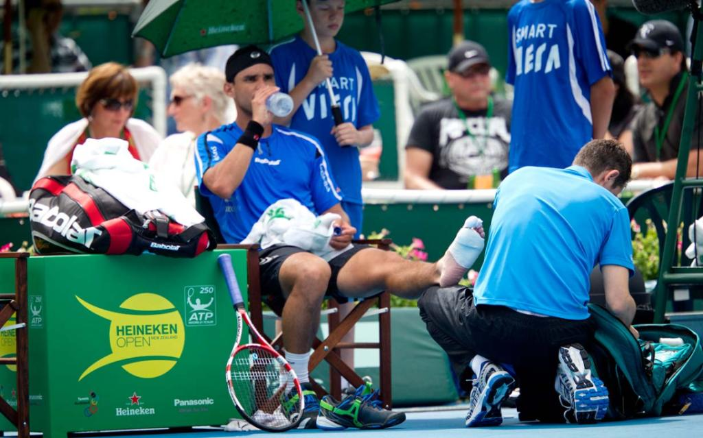 Alejandro Falla of Columbia receives medical attention on day one of the Heineken Open in Auckland.