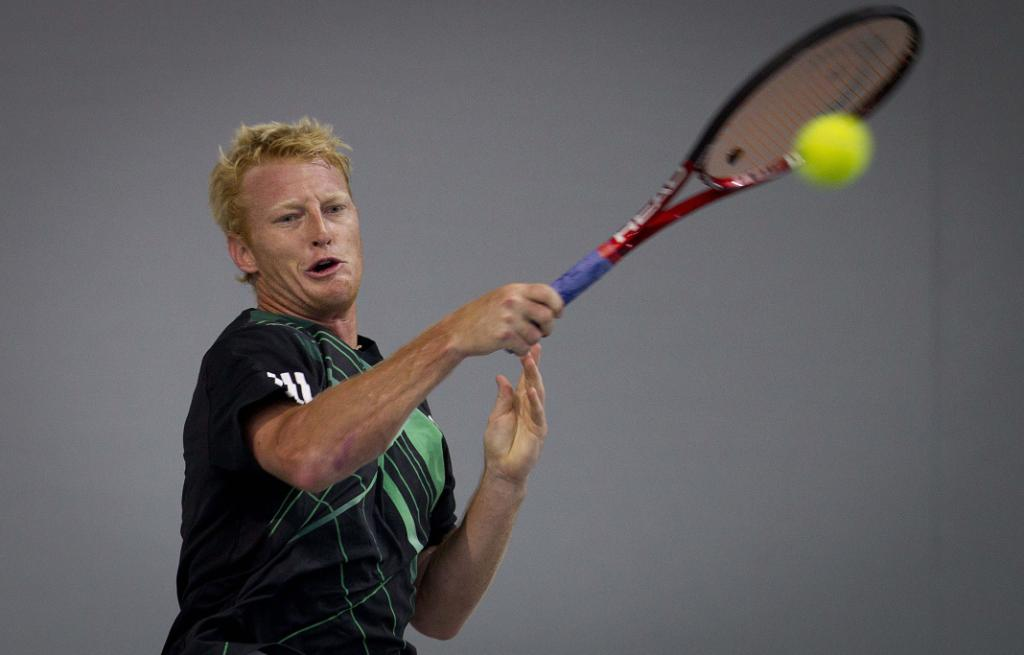 New Zealander Daniel King-Turner takes on Javier Marti from Spain in the qualifiers for the men's Heineken Open.