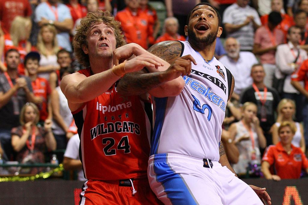 Jesse Wagstaff of the the Wildcats and Breakers' Benny Anthony Jnr. compete for the ball.