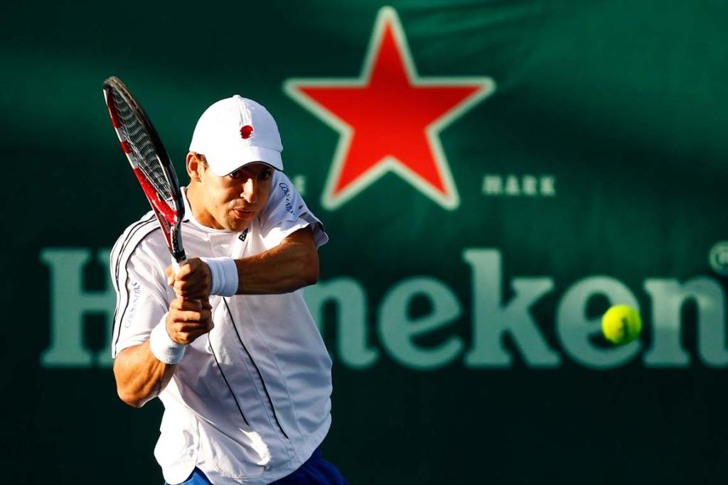 Columbia's Santiago Giraldo takes on New Zealand's Michael Venus during a first round singles match at the 2012 Heineken Open in Auckland.
