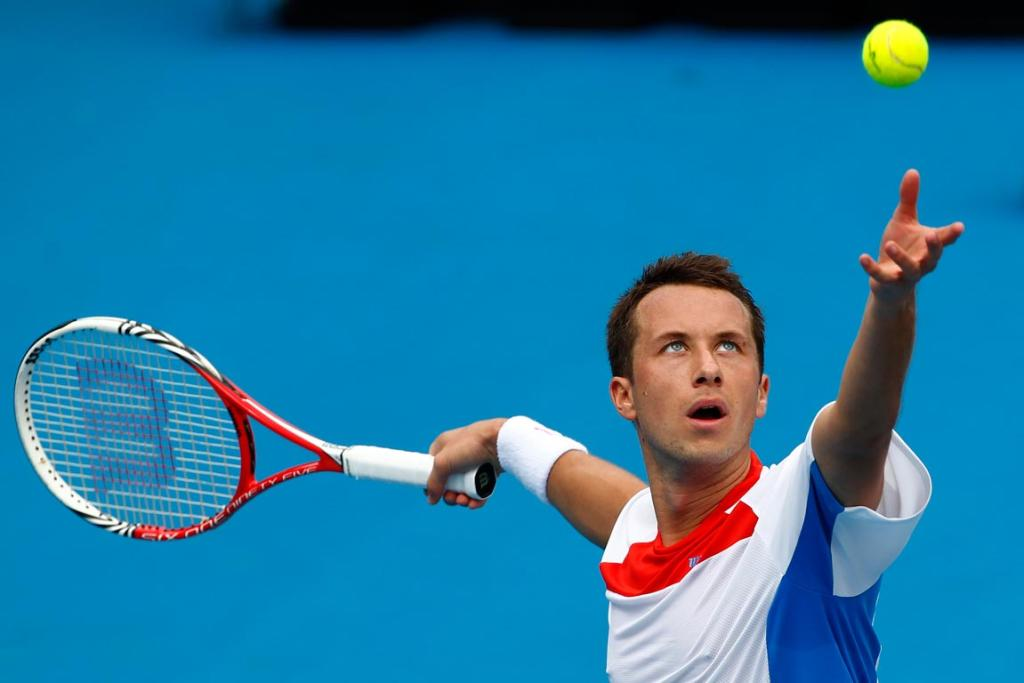 Philipp Kohlschreiber serves during his match against Stephane Bohli.