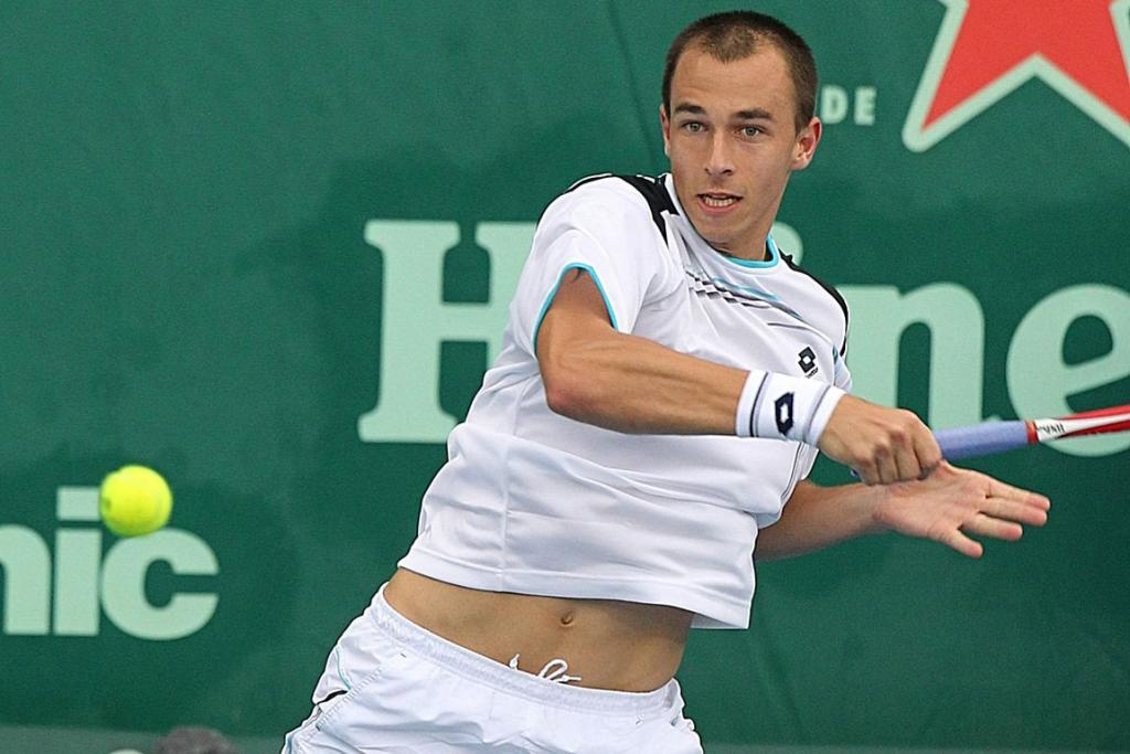 Lukas Rosol in action against David Ferrer of Spain.