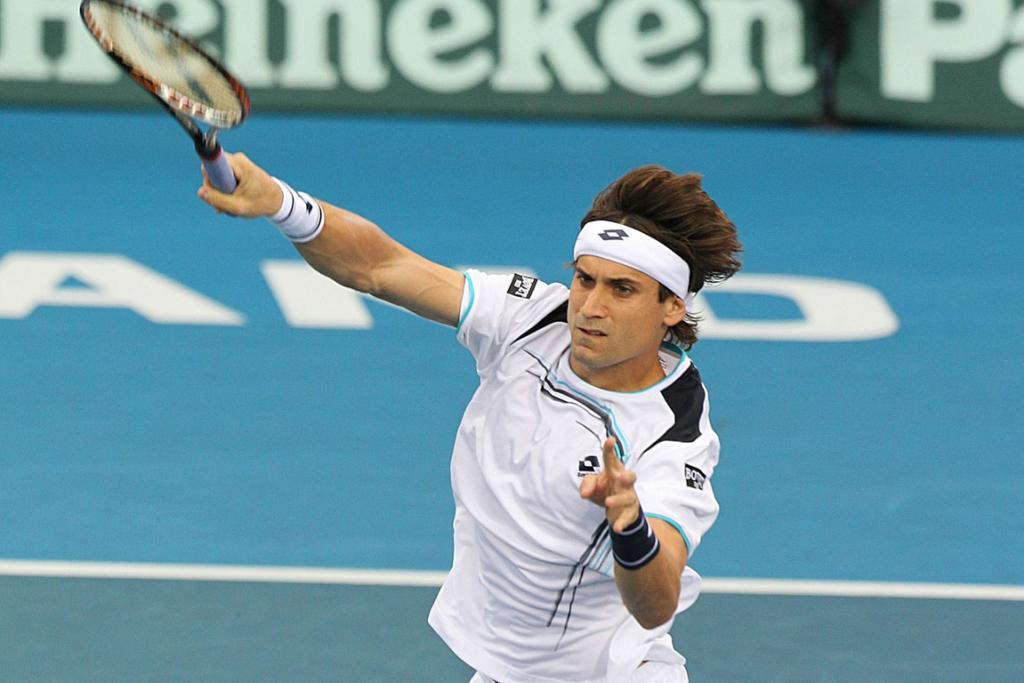 David Ferrer of Spain in action against Lukas Rosol.