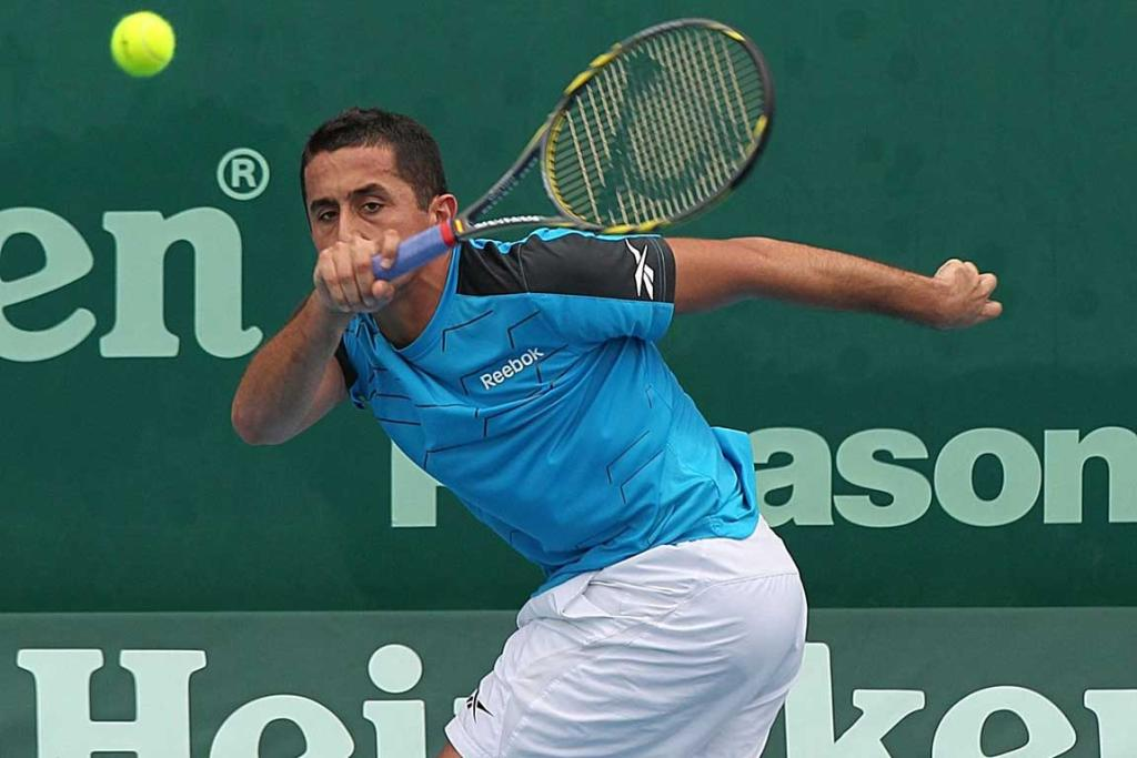 Nicolas Almagro of Spain plays a shot during his second round match against Santiago Giraldo.
