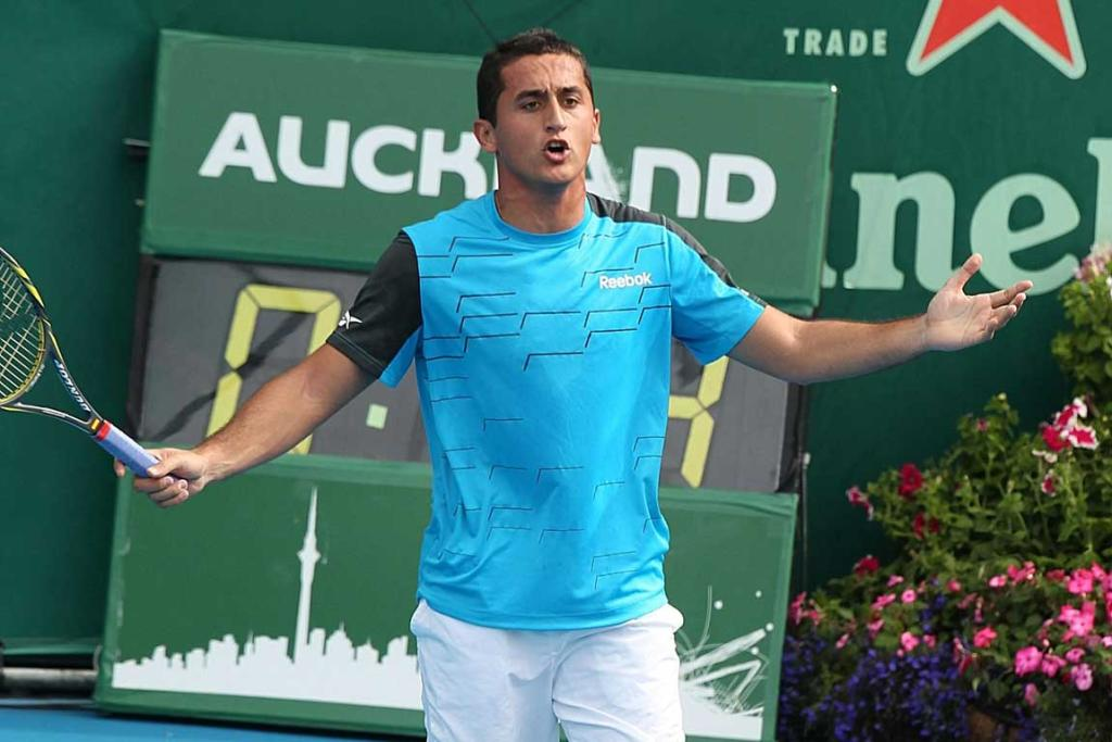 Nicolas Almagro of Spain disputes a call during his second round match against Santiago Giraldo.