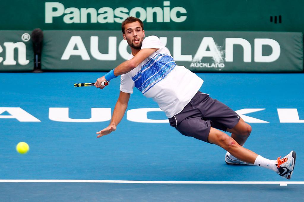 Benoit Paire slips returning a shot during his quarterfinal match against Olivier Rochus.