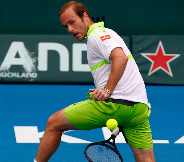 Olivier Rochus plays the ball between his legs during his quarterfinal match against Benoit Paire.