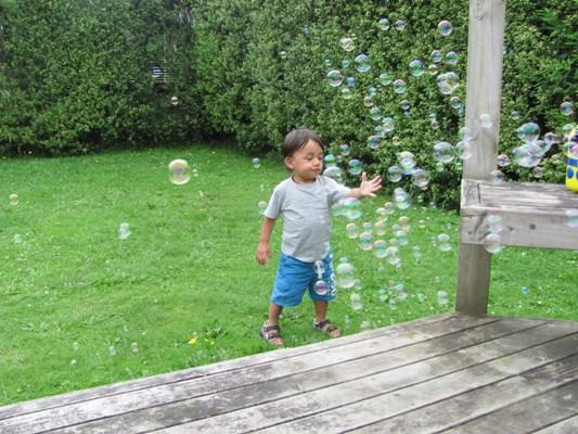 BUBBLE FUN: Peter Mason, 18 months, plays with bubbles from his bubble machine on a nice summer afternoon.