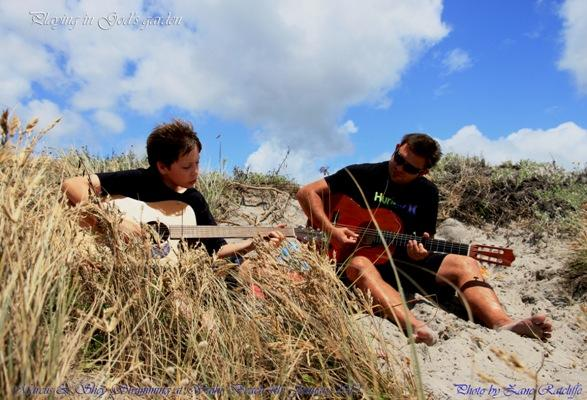 Surf music: Zane Ratcliffe captured Marcus Ratcliffe and Shey Taupaki strumming the day away at Waihi Beach.