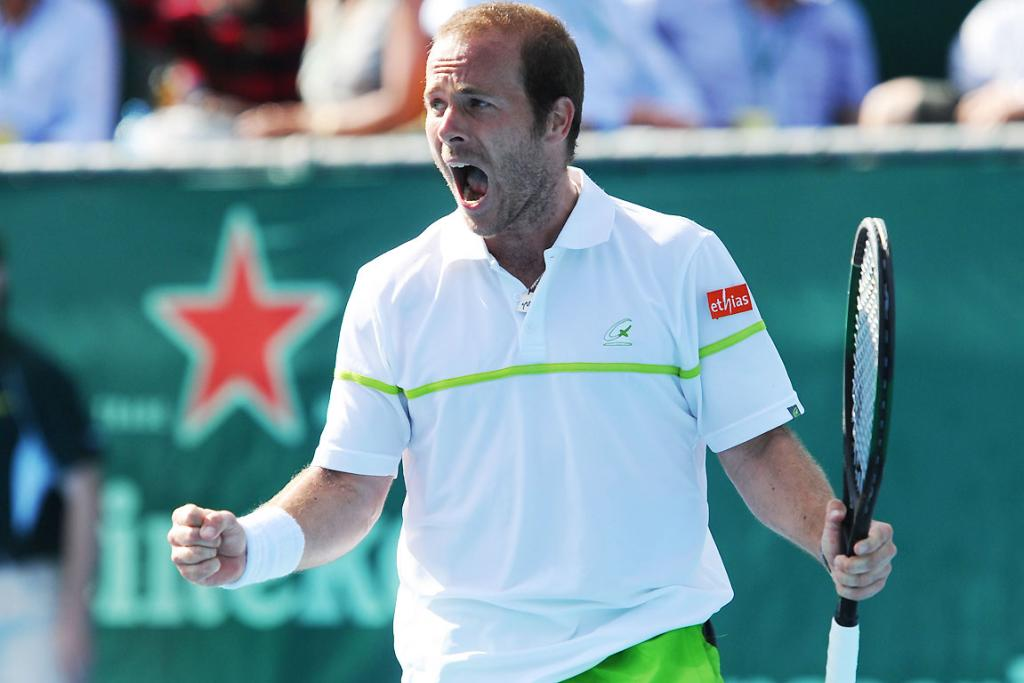 Belgium's Olivier Rochus celebrates winning his semifinal singles match at the Heineken Open.
