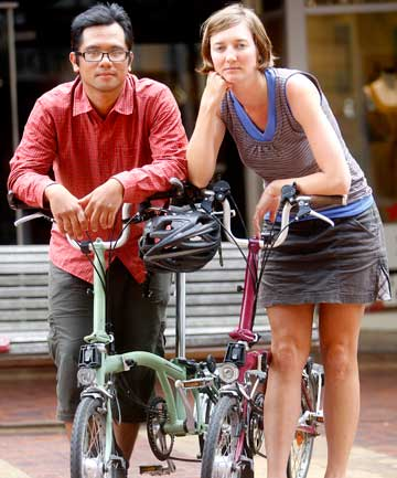 "SHOCKED: United States cycle tourists Russ Roca and Laura Crawford. ""The whole thing was surreal,'' said Mr Roca."