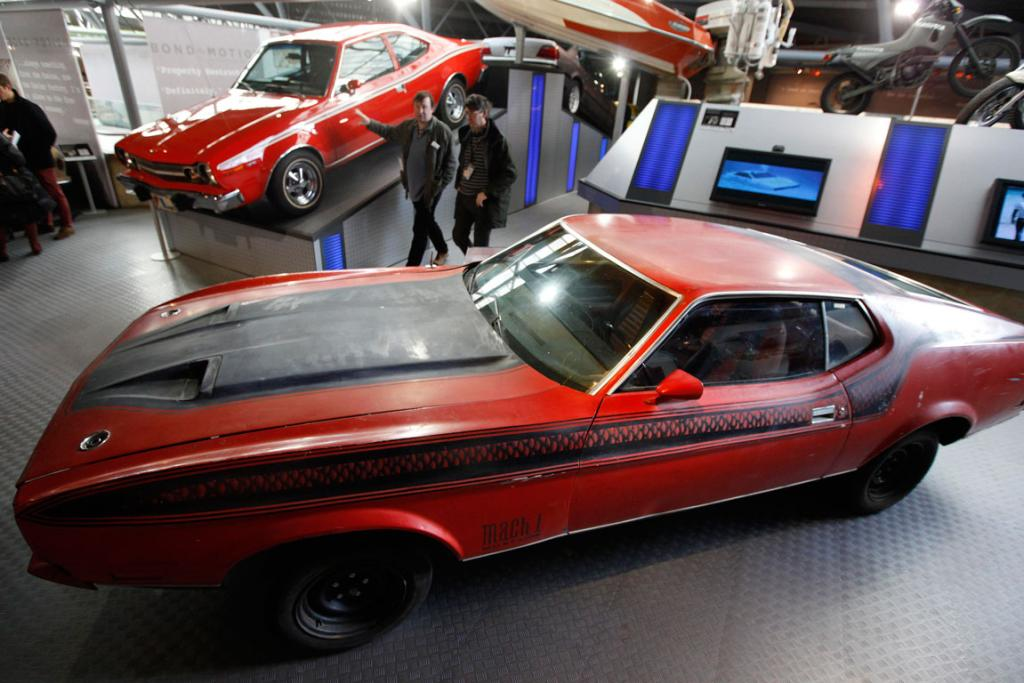 Visitors walk past a Ford Mustang Mach 1 from the James Bond Film Diamonds are Forever at the Bond In Motion exhibition, showcasing a wide variety of vehicles used in the films.
