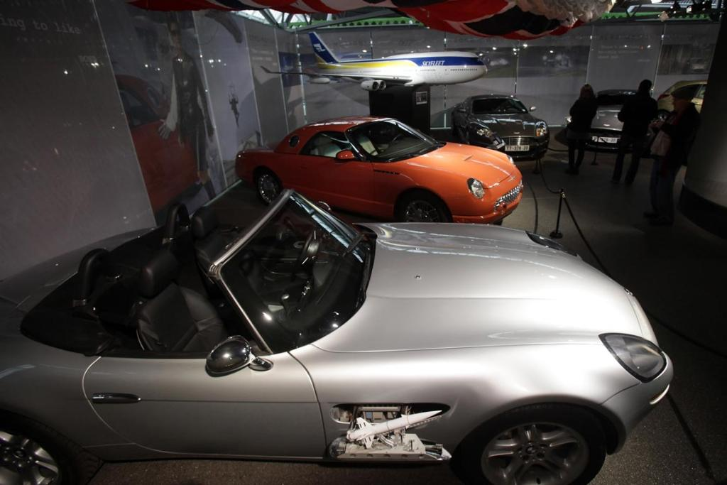 People look at cars including a BMW Z8 that was used in the James Bond film The World Is Not Enough at the Bond In Motion exhibition, showcasing a wide variety of vehicles used in the films.