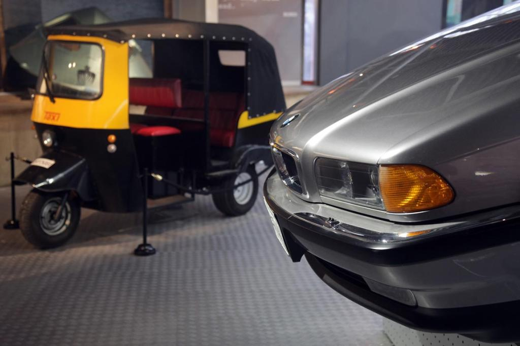 A BMW750iL that was used in the 1997 James Bond film Tomorrow Never Dies and a Tuk-Tuk taxi that was used in Octopussy in the Bond In Motion exhibition, showcasing a wide variety of vehicles used in the films.