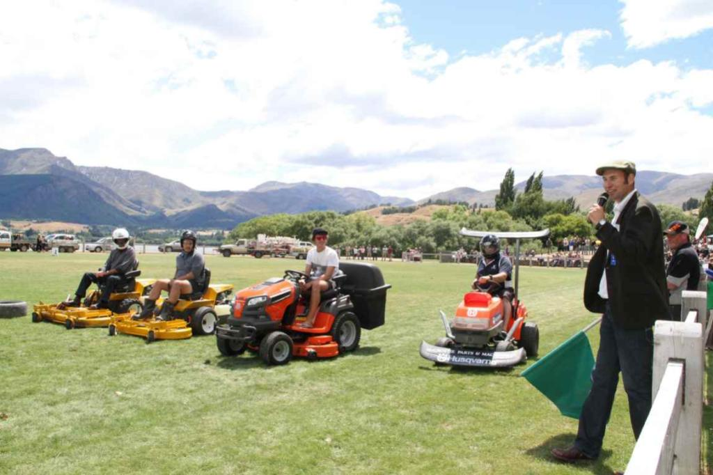 Lake Hayes A & P Show Society president Mike Smith gets ready to raise the flag to start the lawn mower race.