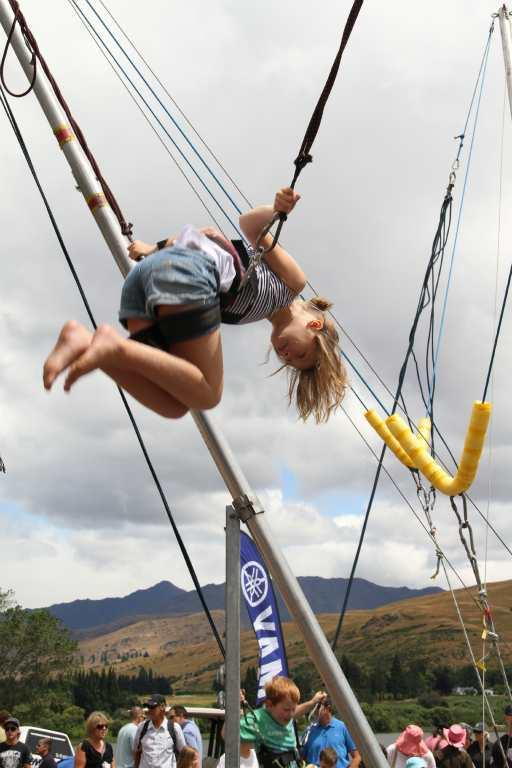On holiday from Fiji, Kelsey Stephens, 10, shows off her skills on the bungy trampoline at the Lake Hayes A & P Show.