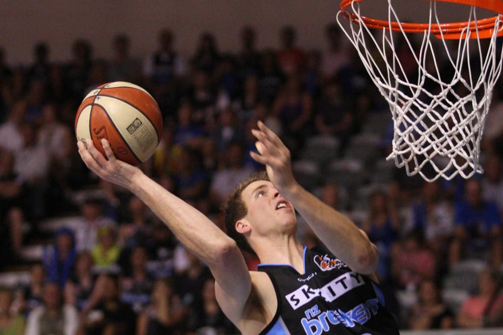 Breakers forward Thomas Abercrombie flies at the basket against the Melbourne Tigers.