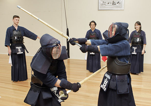 WARRIOR SPORT: Christchurch kendo fighters Blake Bennett, left front, and Akiyo Yamaguchi Ellin, spar as Ramon Palmer, left, David Wong and Alicia Cavan watch after the five were selected for the New Zealand team.