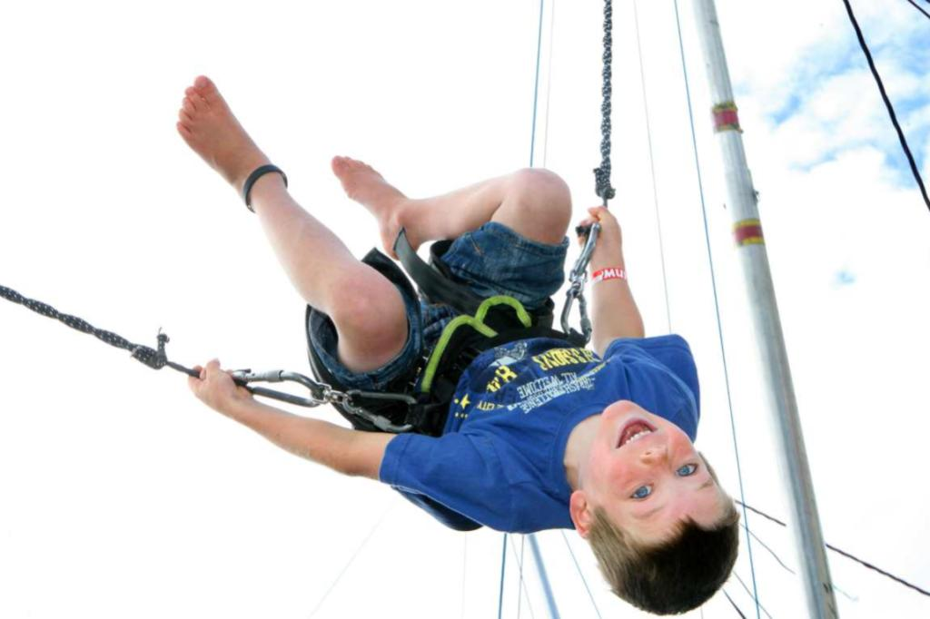 WINTON A & P SHOW: Reed Tong, 6, enjoys the vertical bungy.
