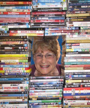BLOWN AWAY: Lynette Stevenson with some of the hundreds of DVDs readers of The Leader have donated to the Cancer Society's Daffodil House.