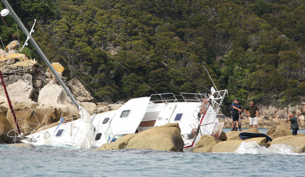 The yacht Okiana on the rocks off Pitt Head reef at the entrance to Torrent Bay and Anchorage.
