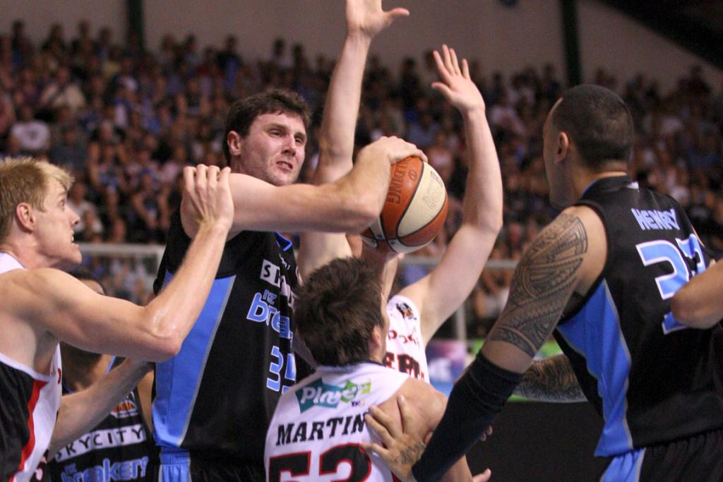 Breakers centre Alex Pledger grasps possession during the 73-67 win over the Perth Wildcats in Auckland.