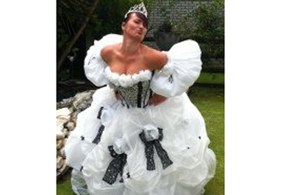 Riki from Otorohanga wearing a wedding dress made out of Garden Frost Cloth at the Wellington Sevens.