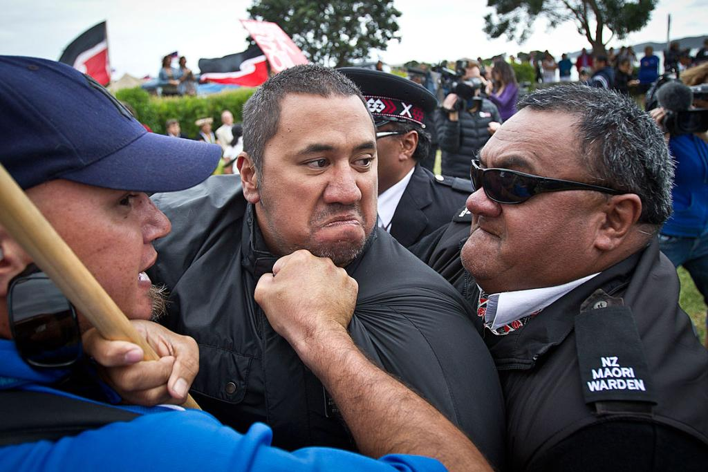Security hold a protester back.
