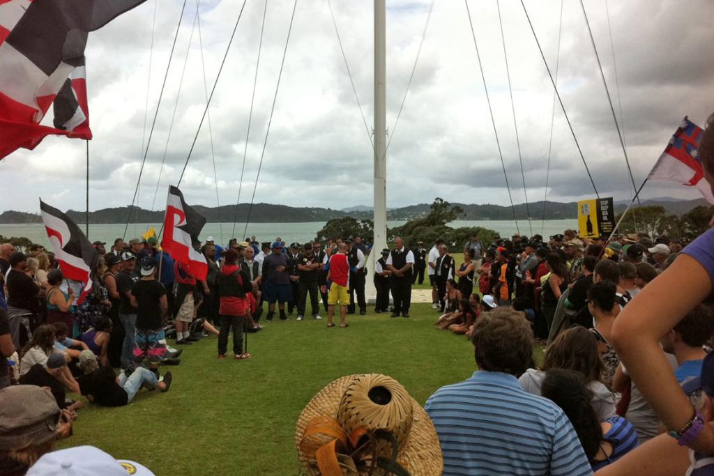 Protesters gather at Waitangi's flagpole.