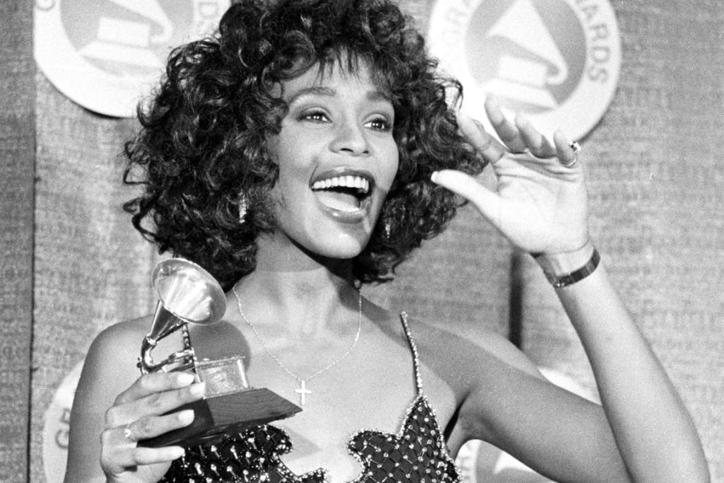 Whitney Houston poses with her Grammy after she was named Best Pop Vocal Performer - Female at the 30th annual Grammy Awards at New York's Radio City Music Hall in 1988.