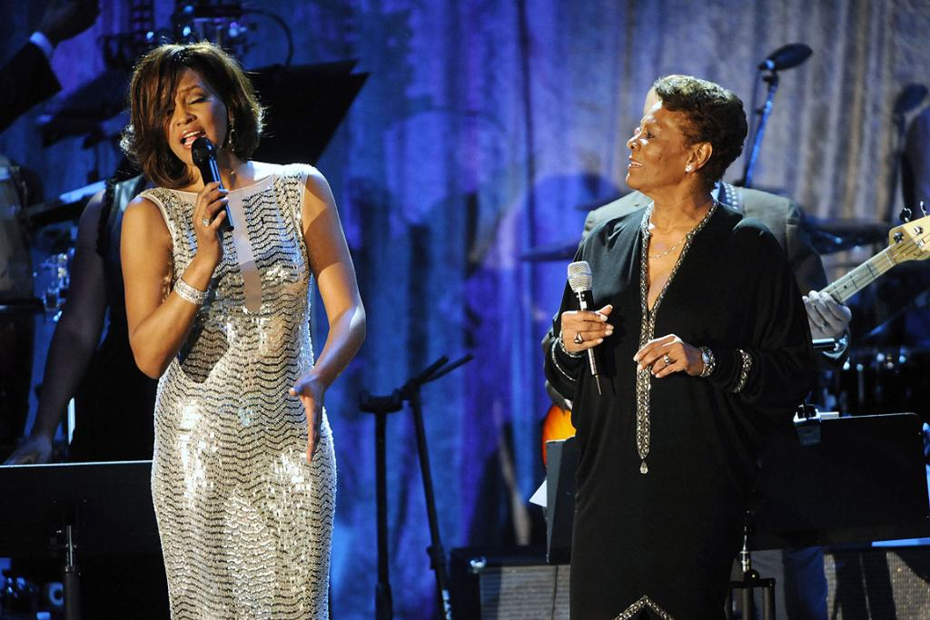 Whitney Houston and Dionne Warwick perform at the 2011 Pre-Grammy Gala & Salute to Industry Icons in Beverly Hills, California.