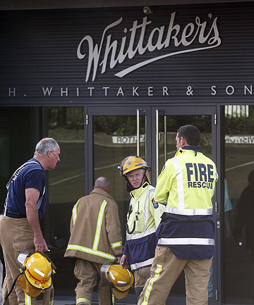 'WE HAD TO DO SOMETHING ABOUT IT PRETTY QUICKLY': Firefighters outside the Whittaker's chocolate factory in Porirua, where a worker suffer caustic soda burns.