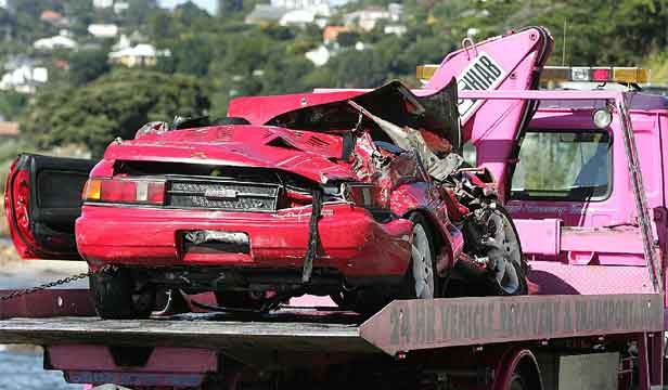 FATAL CRASH: Robin Sayster's car is taken from the Karaka Bay, Wellington, where he died after crashing on to rocks.