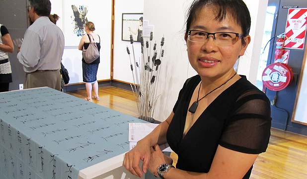 WINNER: Artist Penny Lin stands next to her work Fish, which focuses on the ecological well being of the Tamaki Estuary. Ms Lin won the $5000 grand prize in the Estuary Art Awards.