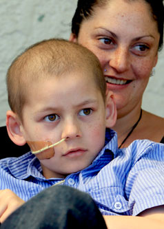 BATTLING ON: Renea Pidduck with her son Phoenix Stafford, 9, of Nelson, who has Ewing's sarcoma of the spinal cord.