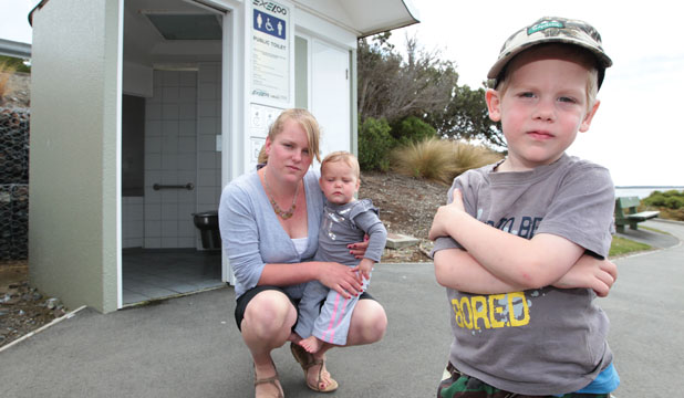 SCARY PLACE: Bluff toddler Zachery Wakelin, with his mother Jessie and 9-month-old sister Maddi Wakelin-Burt, was terrified during his ordeal trapped inside a public toilet.